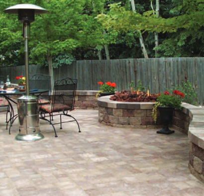 Paver patio with retaining wall and planters