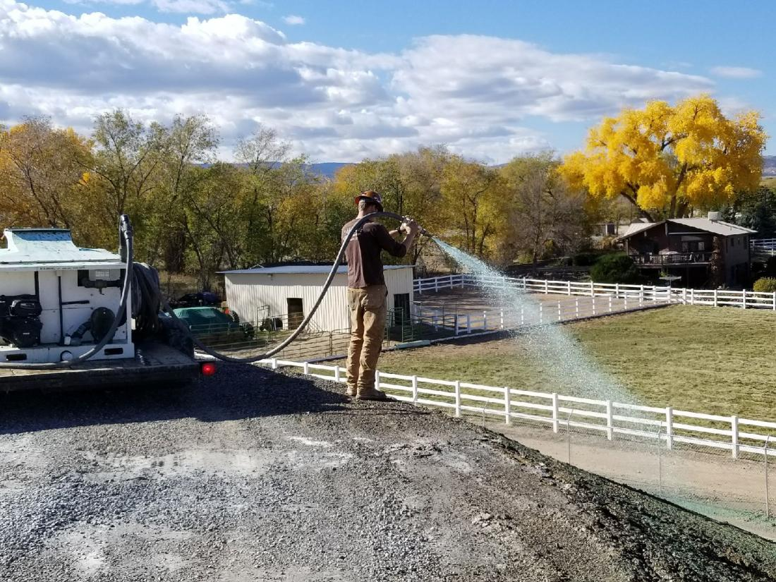Hydro seeding a hillside for an irrigation district project.