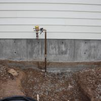 Installation of a Febco 765 PVB coming out of the crawl space.